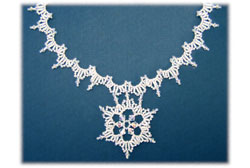 Center Stage Snowflake Necklace