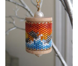 Dolphins Sunset Spool Ornament